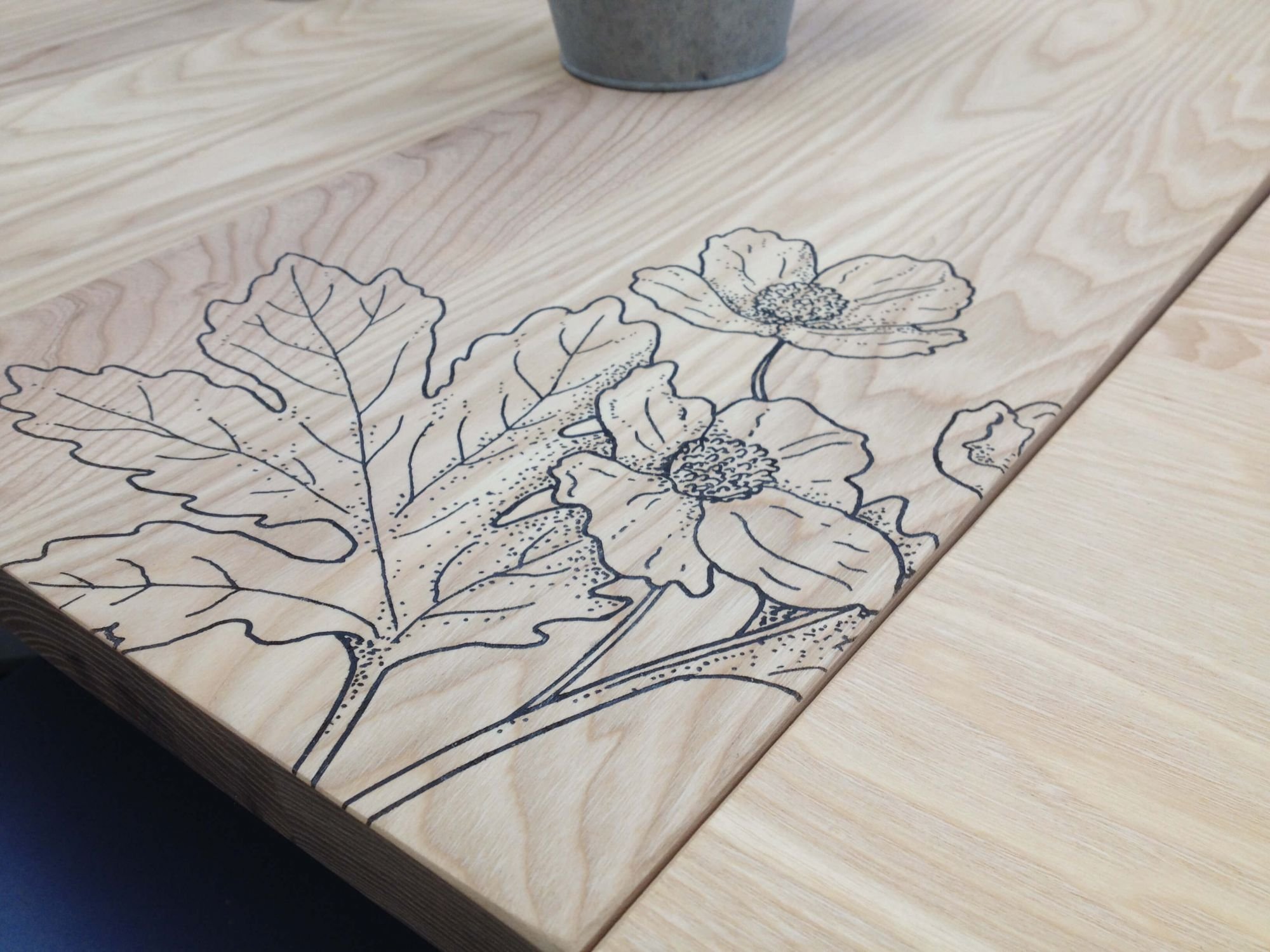 Beautiful laser etching of flowers on our tables